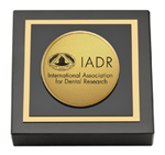 International Association of Dental Research Paperweight  - Gold Engraved Medallion Paperweight